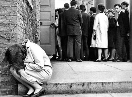 A young girl cried outside a memorial service being held for President Kennedy at Harvard University on Nov. 23, 1963.